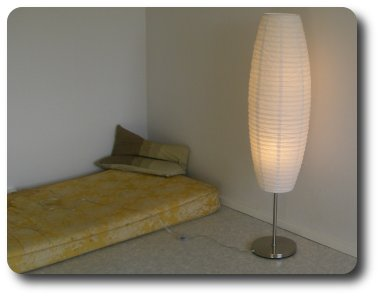 [A picture of the alcove with a mattresss and a lamp.]