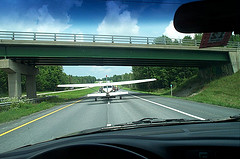 An aircraft being towed after forced landing on a highway.  Picture by Vermont Agency of Transportation via Flickr